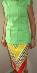 Vintage green business casual with V-striped skirt. Vintage green business casual with V-striped skirt.