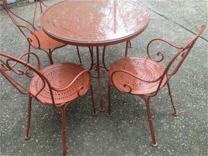 Vintage Woodard wrought iron patio table and chairs.